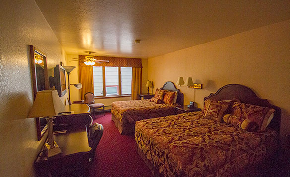 large hotel room with two double beds/