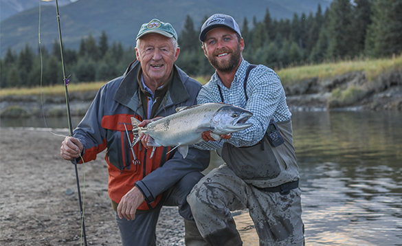 Chris Tarrant and angling guide with a coho salmon caught in Alaska/