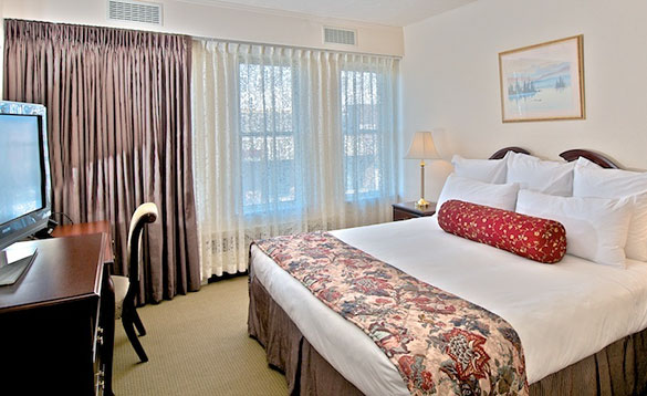 Hotel bedroom with double bed at the Historic Anchorage Hotel/
