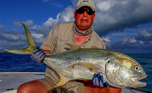 Angler holding a jack crevalle fish caught in Florida/