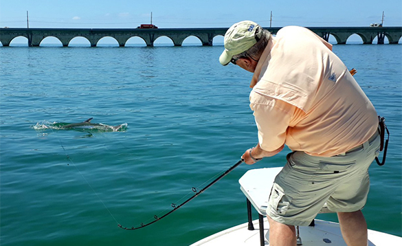 Angler fishing for Tarpon from a boat in Florida/