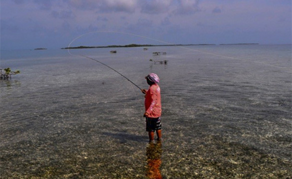 Angler fly fishing in Belize/