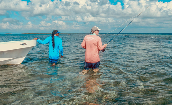 Two anglers fishing from the shallow waters in Belize/