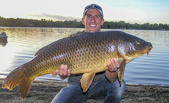 Angler with a carp caught in Canada/
