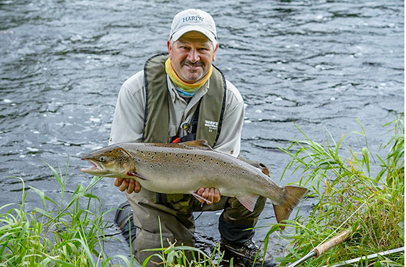 Angler holding a salmon caught in Co Mayo/