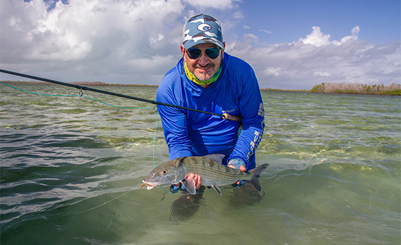 Angler with bonefish in Cuba/