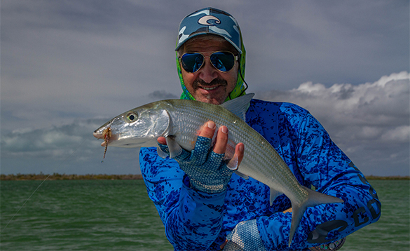 Angler holding a bonefish caught in Cuba/
