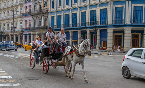People enjoying horse and carriage ride in Havana, Cuba/