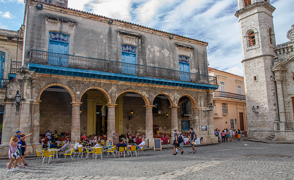 People sitting outside cafe in Havana, Cuba/