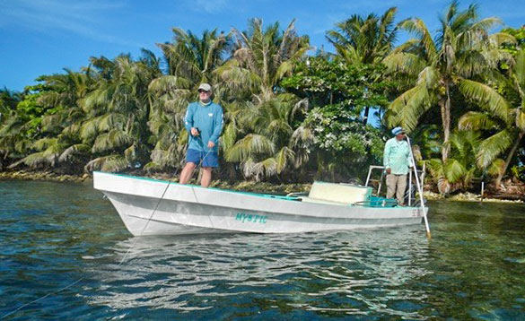 Two anglers fishing from a boat in Belize/