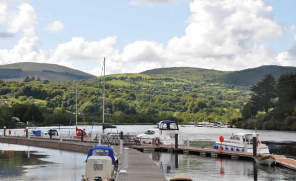 Cruisers moored against wooden jettys on Lough Derg /