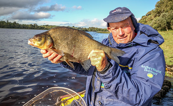 Angler holding a bream caught in a Cavan lake/