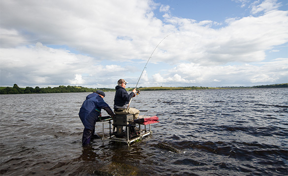 Anglers sitting on a fishing stand fishing in the Cavan Lakeland/