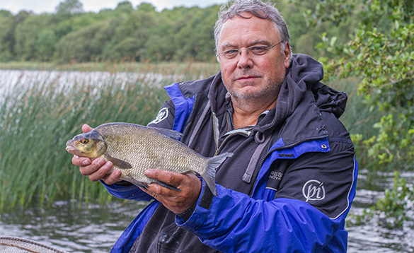 Angler holding a bream caught in Co Cavan, Ireland/