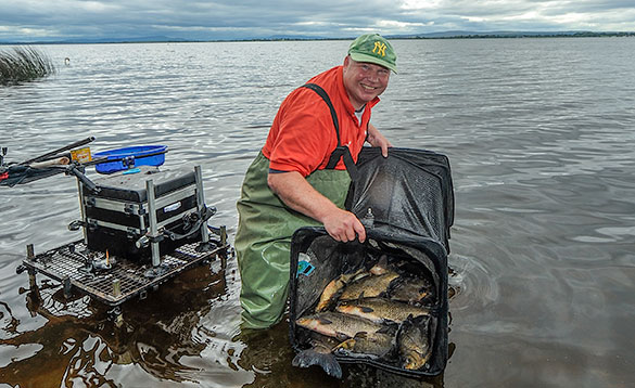 Angler with over one hundred pounds of Irish Bream and Hybrids/