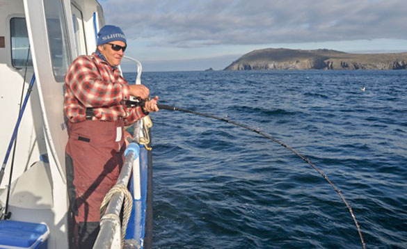 Angler fishing from a boat in Ireland/