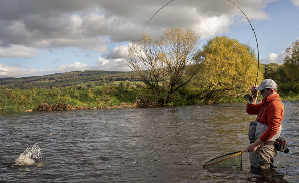 Angler fishing in a river in Ireland/