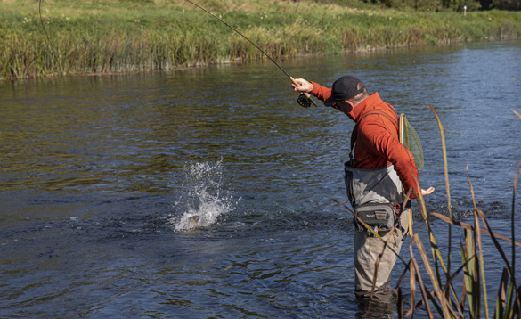 Angler fly fishing in a river in Ireland/