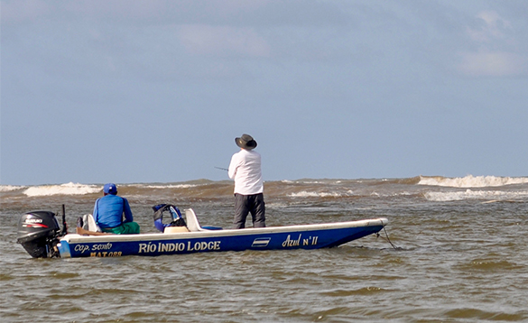 Two anglers fishing from a boat at sea in Nicaragua/