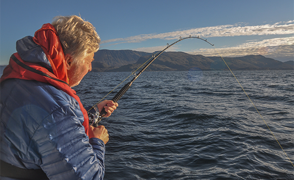 Angler fishing from a boat in North Norway/