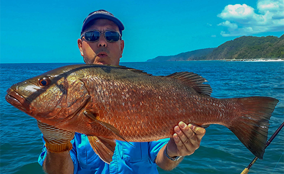 Angler holding a cubera fish caught in Panama/