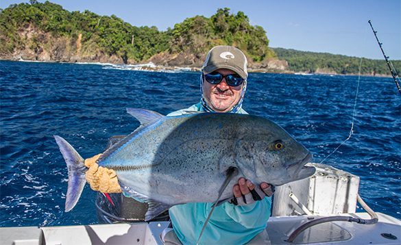 Angler holding a blue trevally caught in Panama/