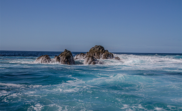 Waves breaking against rocks in the seas around Panama/