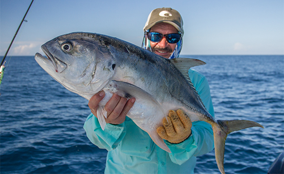 Angler holding a Bigeye Jack caught in Panama/