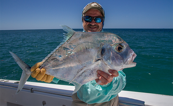 Angler holding a Diamond Trevally caught in Panama/