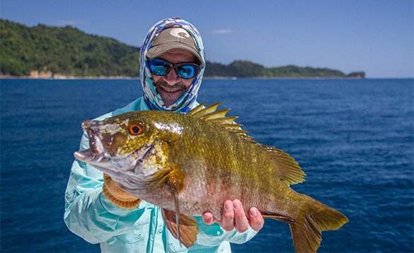 Angler holding a rock snapper caught in Panama/