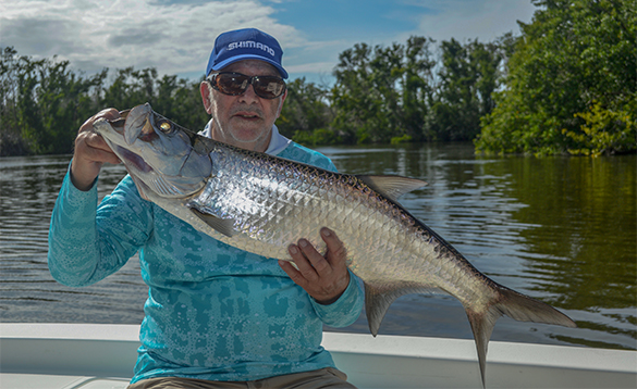 Angler holding a tarpon caught in Puerto Rico/