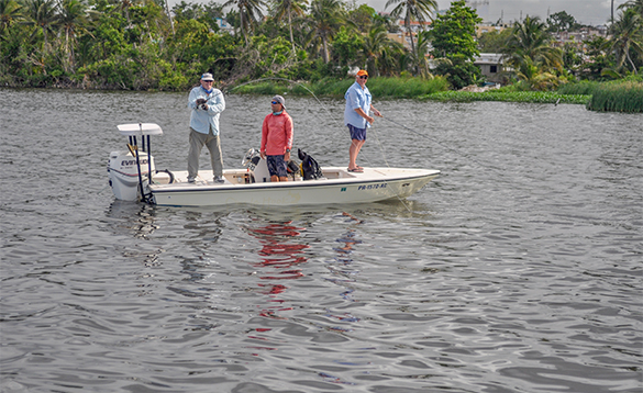 Three anglers fishing from a boat in Puerto Rico/