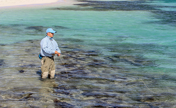 Angler stood in the waters around the Cayman Islands fishing/
